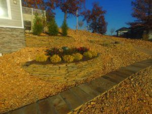Natural stone stepper walkway and terrace planter