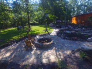 Natural stone fire pit and patio in Laurie, MO