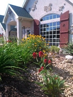 Landscape Designers apply decorative gravel, flowers, shrubs