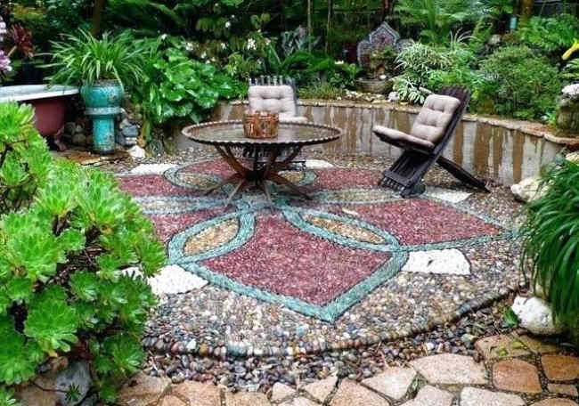 A decorative stone patio built in a colorful design pattern