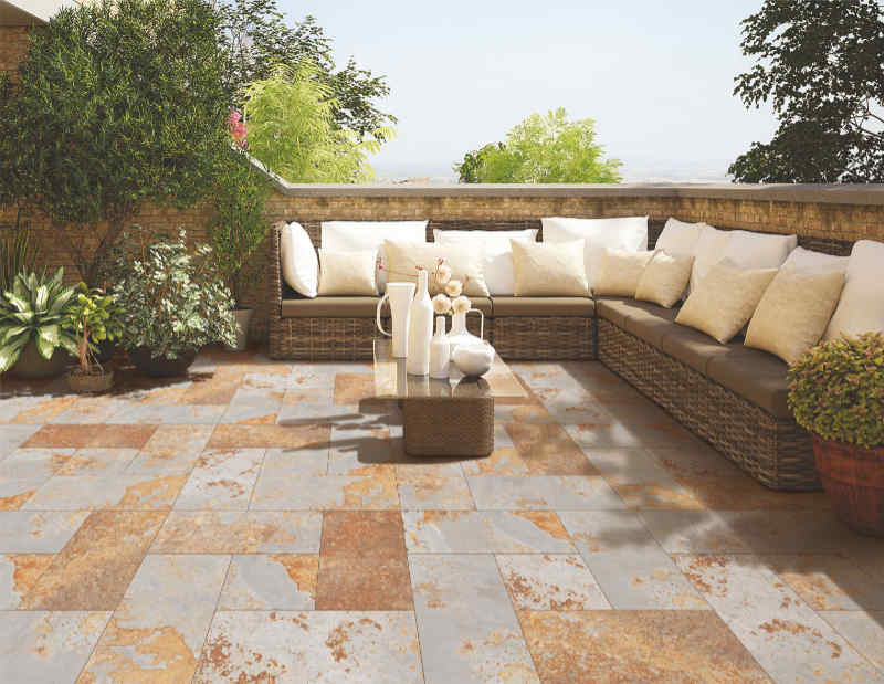 Natural stone tile patio patio furniture, enclosed by a stone wall