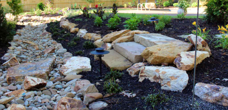 Dry creek bed and landscaping to address water drainage issues