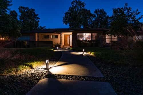 Attractive low voltage lighting alongside a walkway