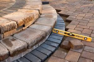 Construction level sitting on pavers