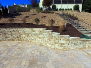 Natural stone retaining wall next to a patio on hillside home at Lake of the Ozarks