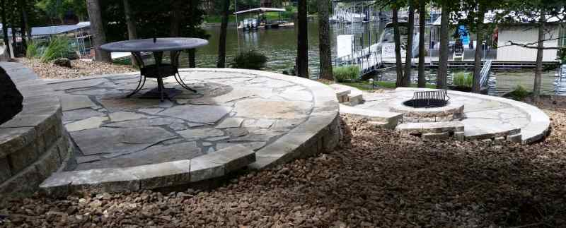 Three terraced patio levels on a slope by Lake of the Ozarks