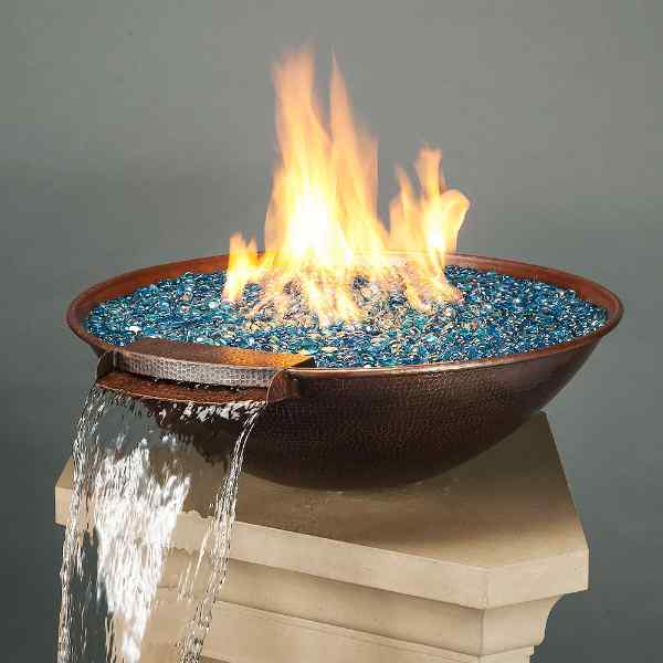 Fire glass beads in a copper fire bowl with a built-in water fountain