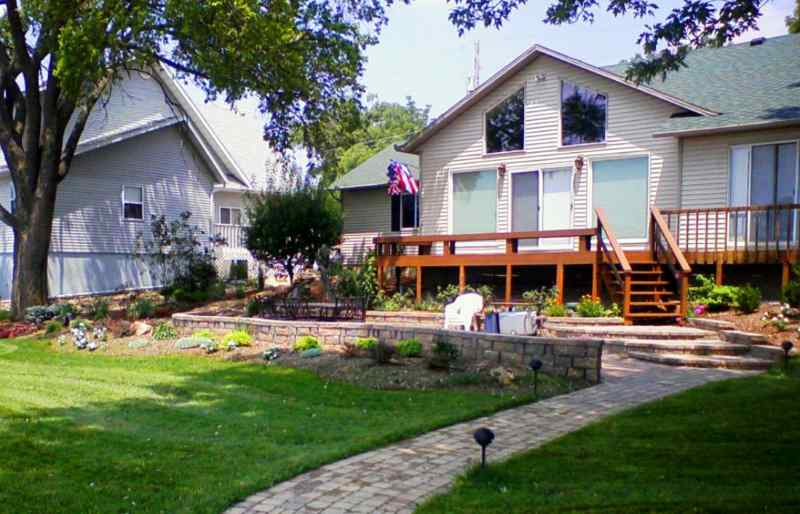 Landscaped and hardscaped home at Lake of the Ozarks with great curb appeal